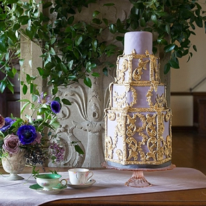 Glam purple and gold wedding cake