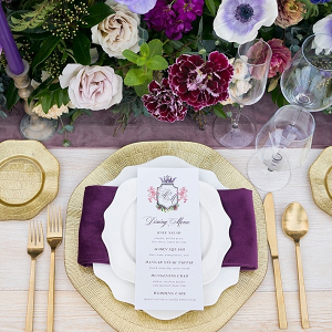 Elegant purple and gold place setting