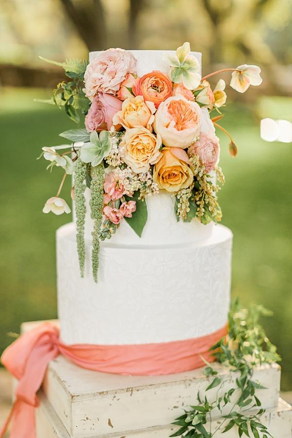 Fresh flower covered wedding cake