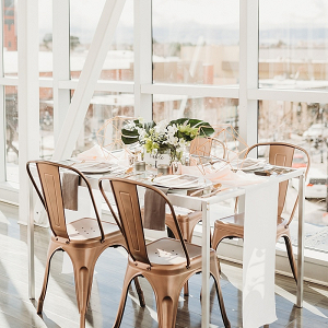 Modern copper and greenery wedding table