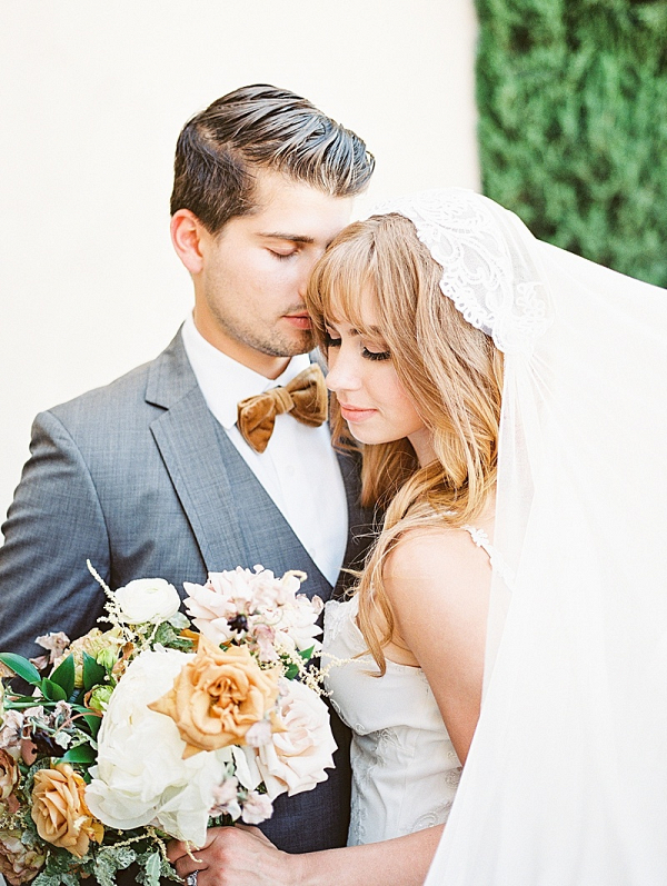 Romantic wedding couple with cream and gold florals