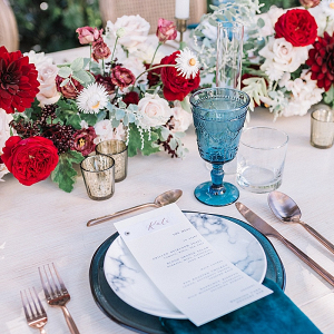 Romantic blue and burgundy wedding tablescape