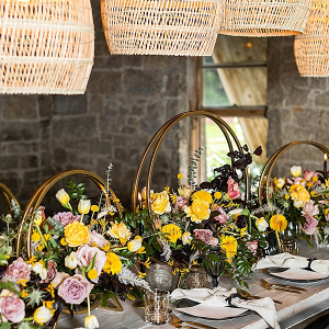 Modern wedding tablescape with boho woven lanterns