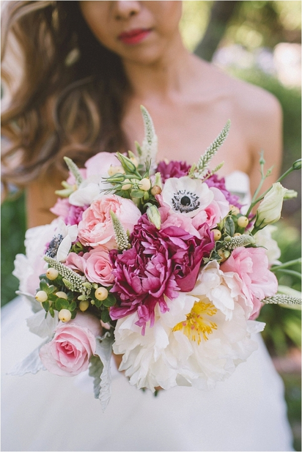 Bride holding a luscious pink, white, and magenta bouquet.