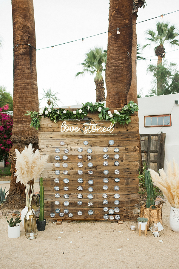 Boho seating chart with neon sign