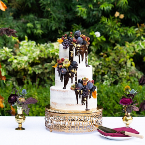 Elegant chocolate drip wedding cake