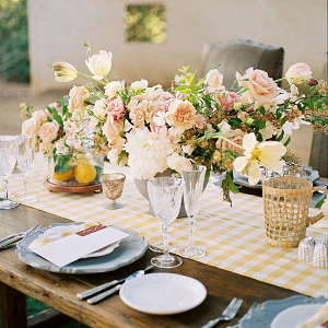 Summer yellow wedding table with gingham table runner
