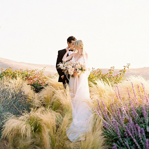 Fine art wedding couple portrait in sunset field