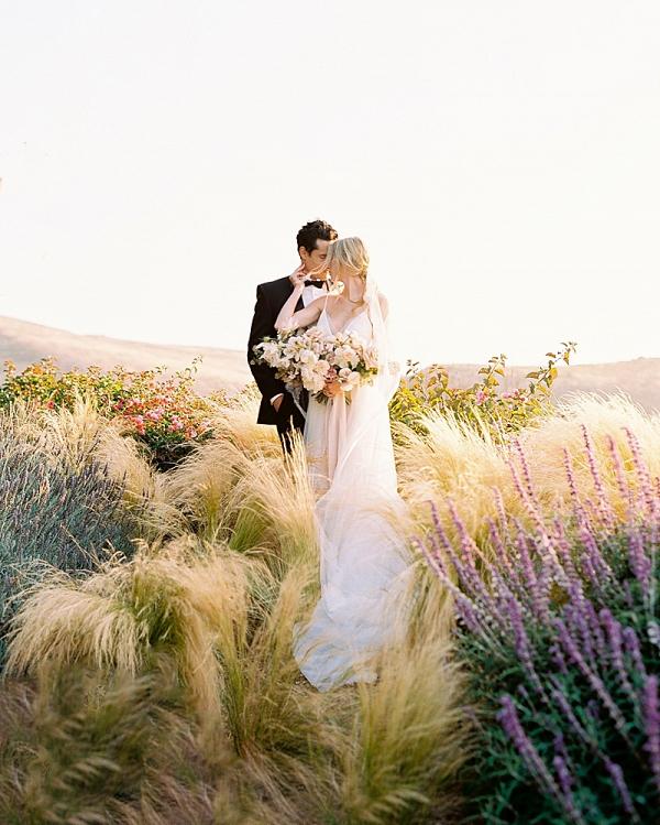 Fine art wedding couple portrait in sunset field