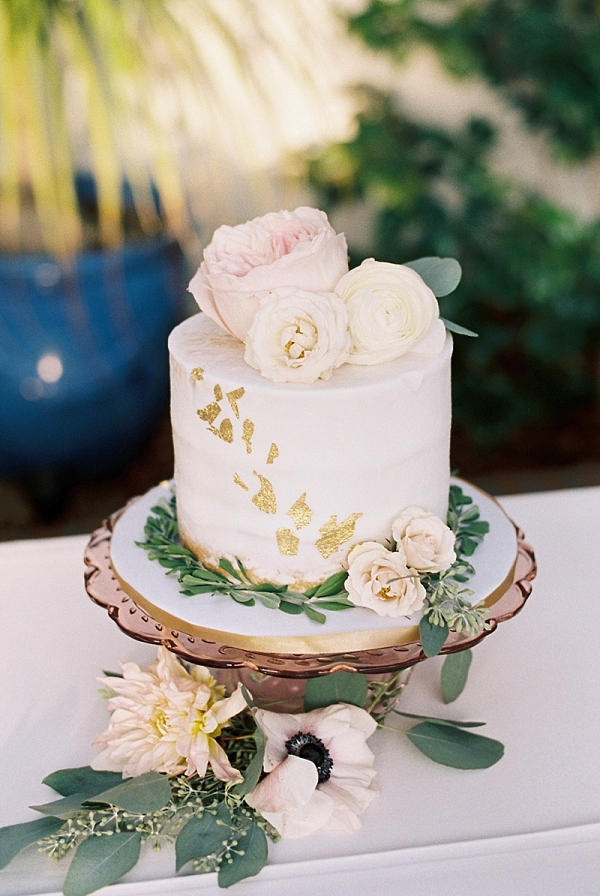 Small wedding cake with gold flakes