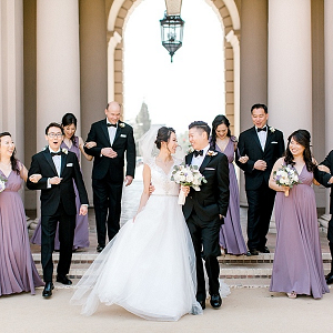 Purple bridesmaid dresses and tuxedo bridal party
