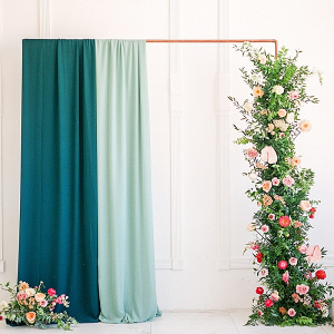 Copper pipe and draping ceremony backdrop