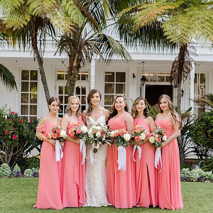 Bridesmaids in bright coral dresses