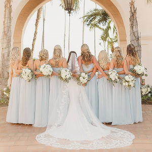 Bridesmaids in long light blue dresses