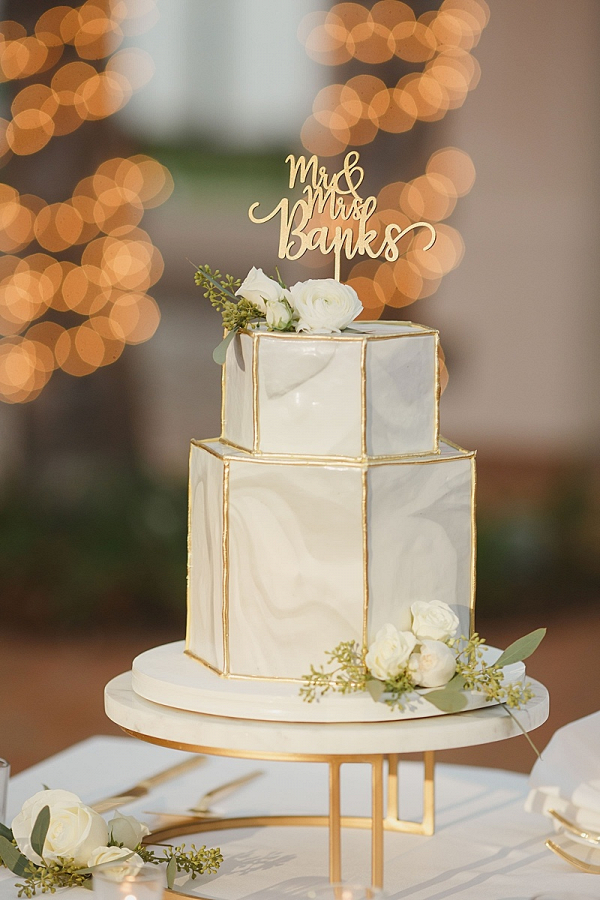 Marble wedding cake with gold topper