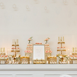 Elegant pink and gold dessert table