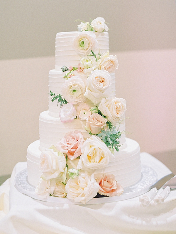 Classic blush flower covered wedding cake