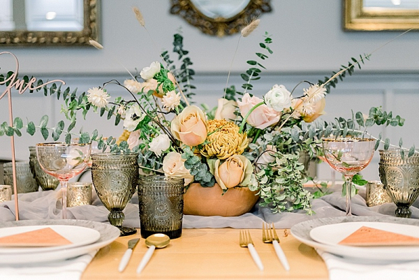 Mustard and cream floral centerpiece