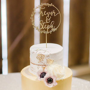 Gold leaf wedding cake with laser cut topper