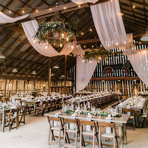 Barn wedding reception with draping