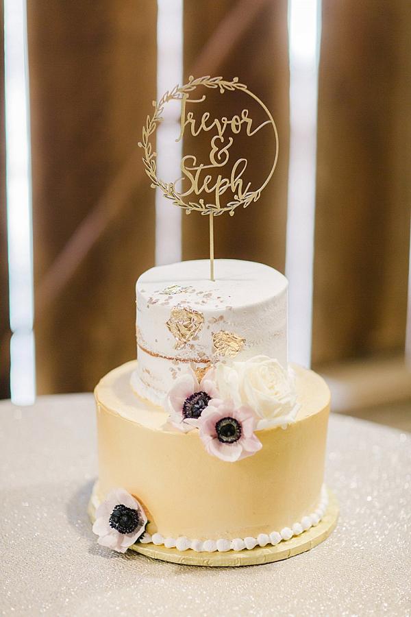 Gold leaf wedding cake with laser cut topper