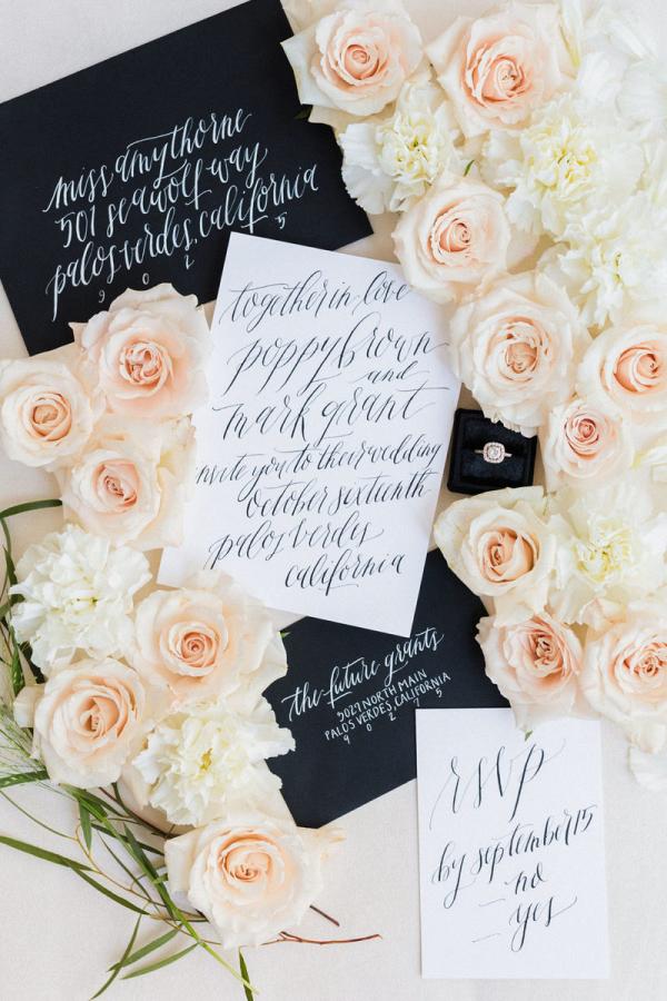 Black and white wedding inspo modern calligraphy invites envelopes