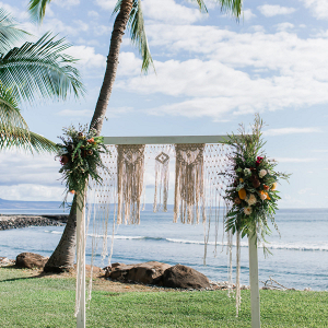 Macrame ceremony arbor by the beach