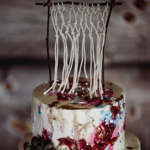 Two tier wedding cake with macrame topper