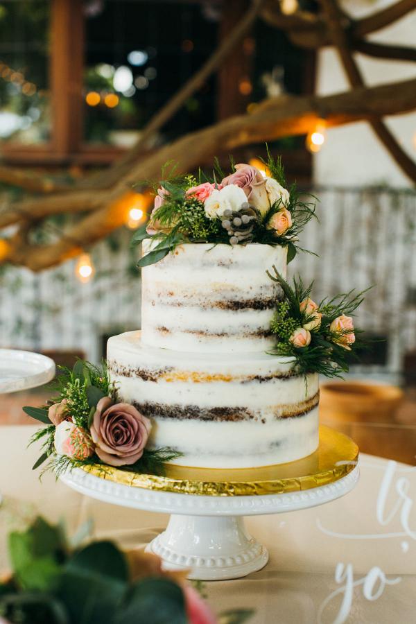 Two tiered white wedding cake
