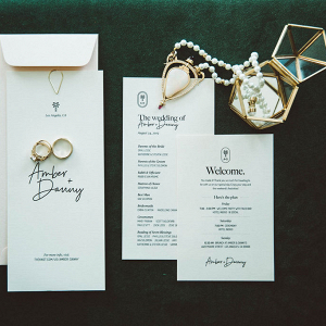 White wedding invitions with a pearl necklace