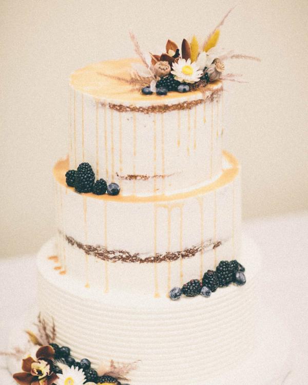 3 tier white wedding cake with raspberries