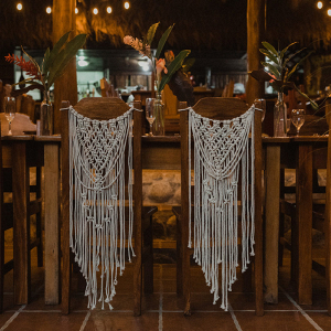 Wooden table and chairs with white macrame