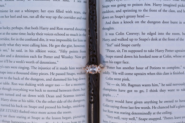 Engagement ring on a Harry Potter book