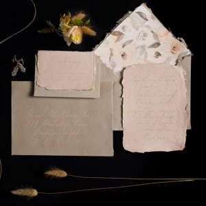 Pink wedding invitation and envelope