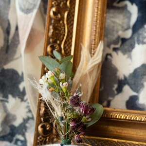 Gold picture frame and a boutonniere