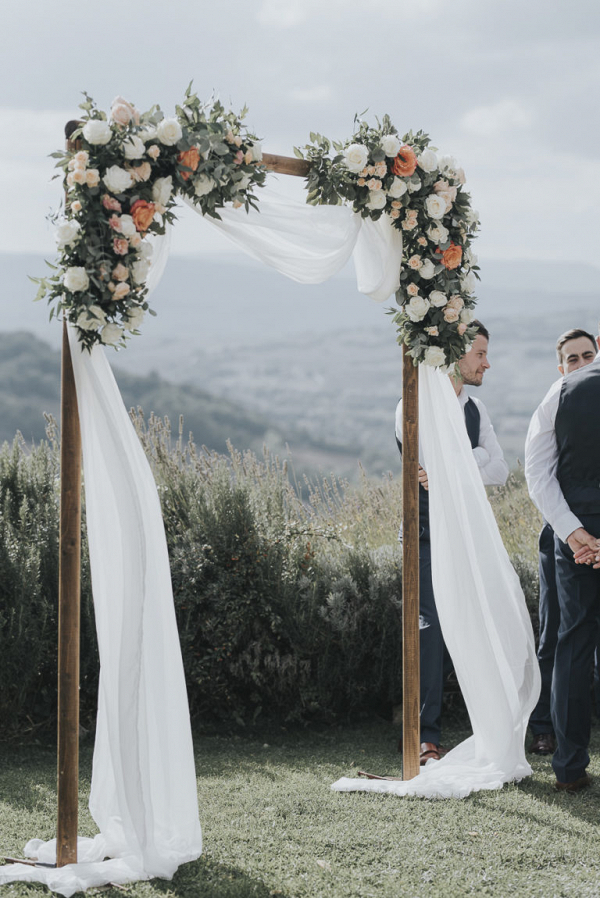 Wooden floral ceremony arbor with the perfect backdrop