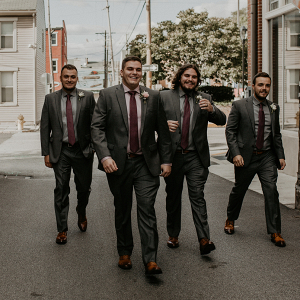 The groom and the groomsmen taking a stroll