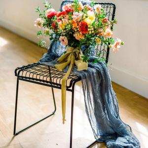 Aesthetic bouquet on black chair