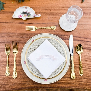 Place Setting Showcasing A Mix Of Floral Meets Gold Rim China Twin Lens Weddings