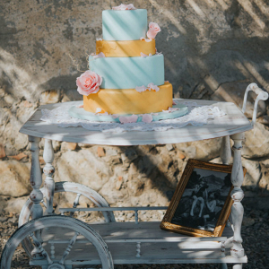 Four tier wedding cake on a trolley
