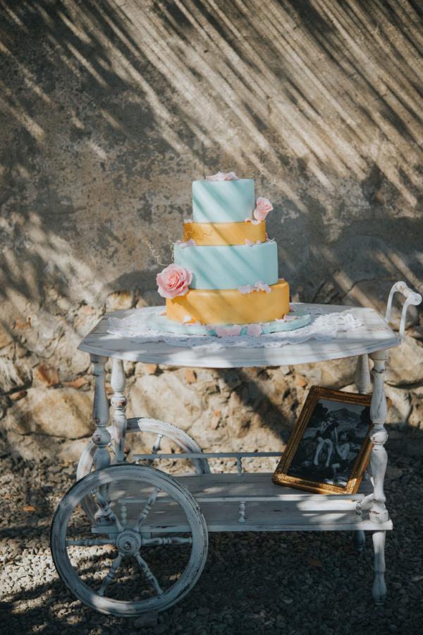 Four tier wedding cake on a trolley