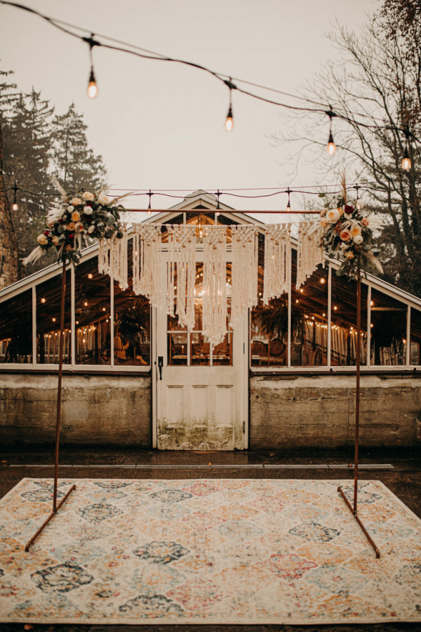 Ceremony arbor with white macrame