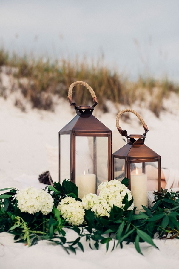 Bronze Lantern Filled With Pillar Candles Set Among Fresh Greens & Hydrangea
