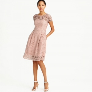 Short blush-colored bridesmaid dress with an illusion yoke and Leavers lace