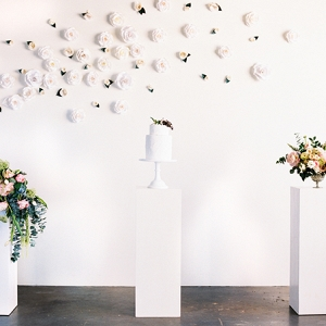 A gallery display of flowers and cake