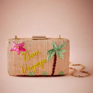 Embroidered straw clutch for a tropical getaway