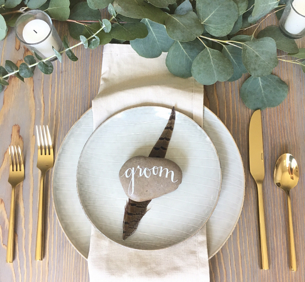 Calligraphed river rock place cards