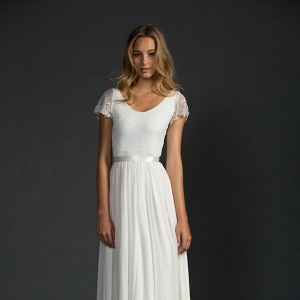 Simple wedding gown with Swiss stretch lace and beaded flutter sleeves