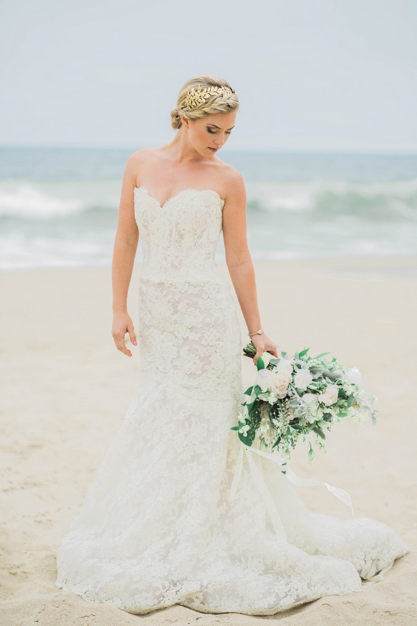 Beachgoing bride in a gilded Grecian headpiece
