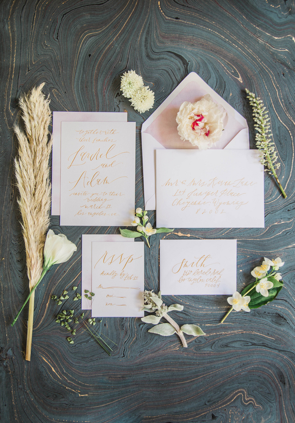 Simple invitation suite with organic calligraphy in muted gold